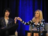 """nick tweed-simmons and shannon tweed share a ring bump during the """"reality royalty"""" panel at the realscreen factual entertainment forum."""