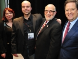 """realscreen summit: so you think you can pitch? winner johnathan walton for his pitch, """"some stupid show"""" (second from left) with realscreen publisher claire macdonald, judge gary lico and host sam rubin"""