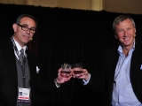 Realscreen Summit: Day 2: In Conversation with David Lyle (pictured, right), interviewer Craig Piligian (left) share a toast