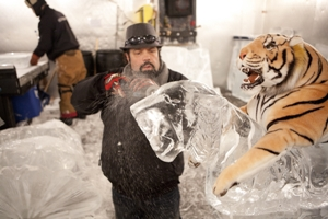 GRAND RAPIDS , MICHIGAN, JANUARY 12, 2011 : RANDY FINCH at works on the carroussel pieces inside the freezer of Ice Sculpture Ltd.. ICE BRIGADE follows former chef Randy Finch and his team of renegade ice artists as they blow the lid off ice sculpting by creating original, unique designs that defy the imagination. (Photo by Jean-Marc Giboux  for Food network)