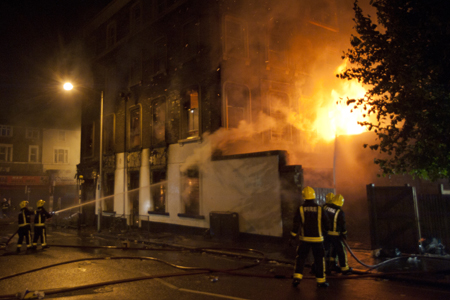 Firefighters tackle a blaze in Croydon, England, following rioting in August 2011. Photo: Todd Geasland © used under a Creative Commons licence