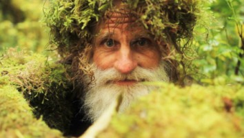 mick dodge popping out of some moss. (photo credit: screaming flea productions)