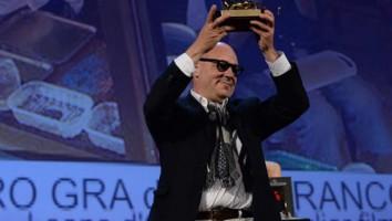"Gianfranco Rossi winning the Golden Lion for ""Sacro GRA"" at the 70th Venice Film Festival"