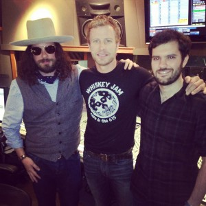 dierks bentley (centre) in the studio with jingle punks' jared gutstadt (right)  and songwriter jeff peters (left).