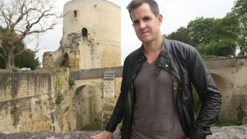 Dan Jones in front of Chinon Castle, a Plantagenet strong hold