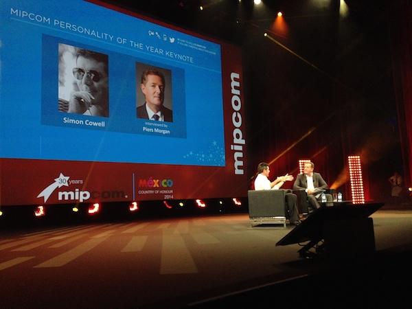 Simon Cowell and Piers Morgan in conversation at MIPCOM 2014. Photo: Adam Benzine
