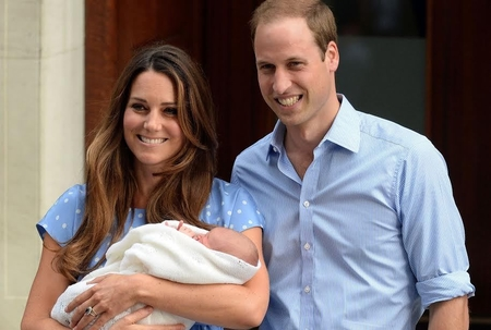 The Duchess of Cambridge and Prince William with Prince George. Photo: Andrew Parsons/REX/Woodcut Media
