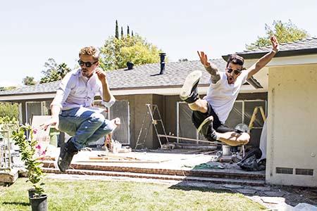 Mark and Derek dancing in backyard
