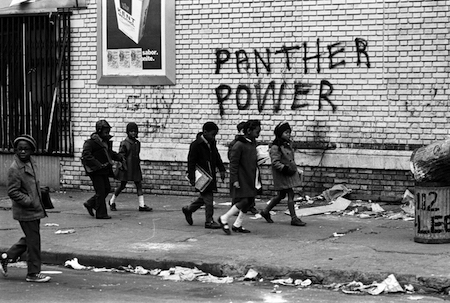 children walk by panther power graffiti (photo: stephen shames)