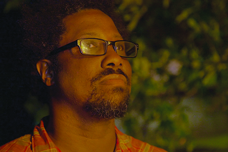 W. Kamau Bell witnessing a cross-burning