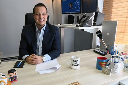 Tommy Desk Shot-min