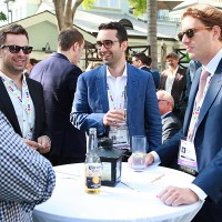 Delegates convene in the garden during the PactUS cocktail reception