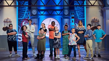 Hosts Donal Skehan and Tia Mowry with the kid competitors on Food Network Star Kids