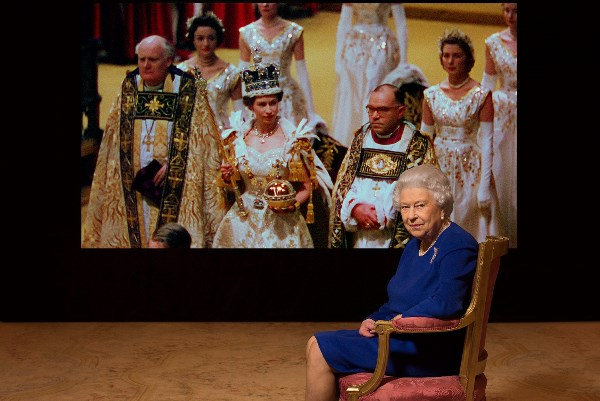 Her Majesty the Queen with archive footage Photo Julian Calder (C) Her Majesty the Queen