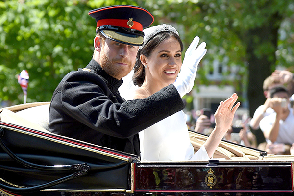 Windsor, UK. 19th May 2018. Meghan Markle and Prince Harry during the carriage procession on the Long Walk Credit: Finnbarr Webster/Alamy Live News