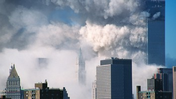 World trade center collapse on September 11th, 2001. The South Tower (WT2) is collapsing with the North tower (WTC1) behind NYC