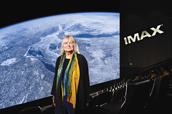 Toni-Myers-at-IMAX-theatre-with-A-Beautiful-Planet-on-screen